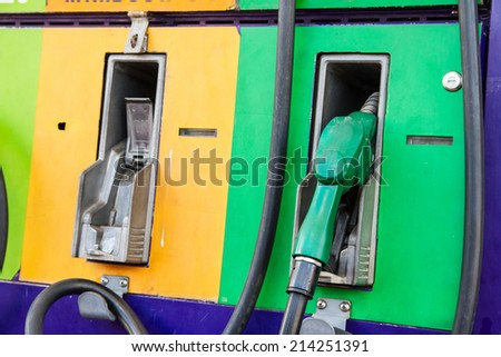 fuel nozzle, gas pump, in service station - stock photo