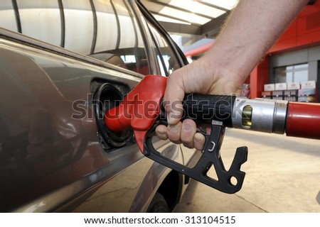 Fuel nozzle with hose - stock photo