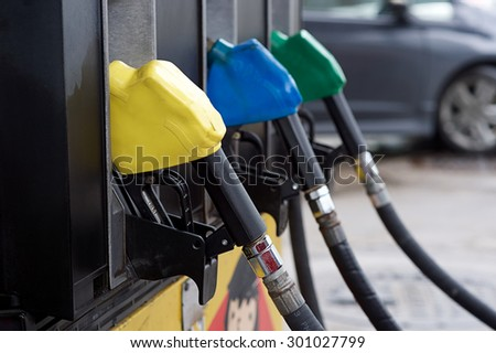 Fuel oil dispenser at petrol filling station. - stock photo