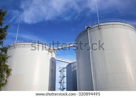 fuel, oil tanks against blue sky - stock photo