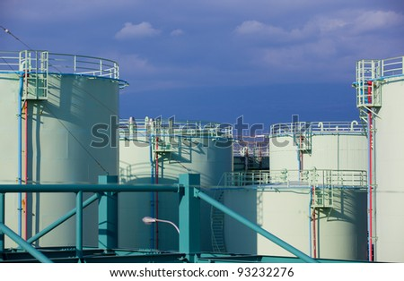 Fuel(oil) tanks in territory of a petrofactory. - stock photo