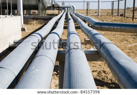 fuel pipes on site - stock photo