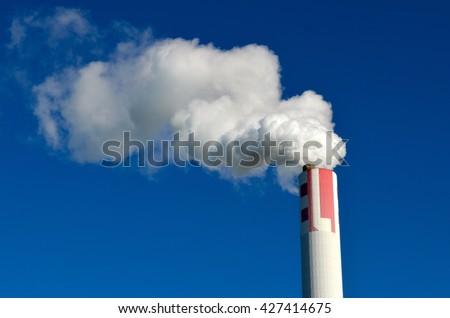 Fuel Power Plant Smokestacks Emit Carbon Dioxide Pollution - stock photo