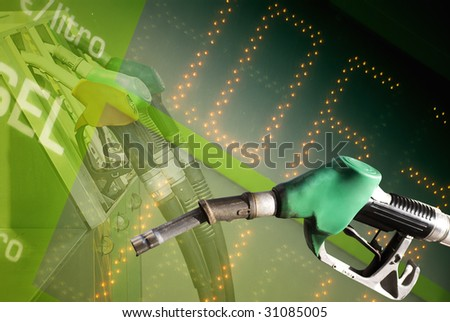 Fuel price background and fuel pump station - stock photo