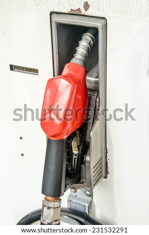 Man Inspecting Fire Extinguisher Against White Stock Photo