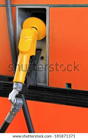 Fuel Pump Nozzle at the Gas service station - stock photo