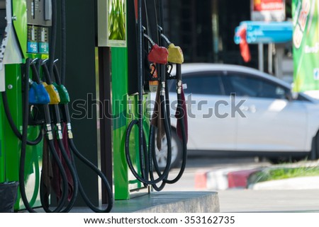 Fuel pumps at a petrol gas station - stock photo