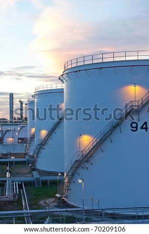 Fuel silo tanks at the petrochemical plant in the morning sphere, the backup energy of the nation - stock photo
