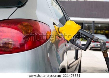 Fuel station service fill energy into your car at gas station - stock photo