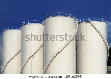 Fuel tank and blue sky - stock photo
