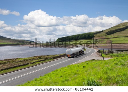 Fuel tanker a long the road - stock photo