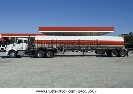 Fuel Tanker Truck at the Gas Station - stock photo