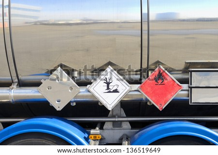fuel tanker with warning signs - stock photo