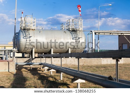 fuel tanks and pipe-line for boiler-house on industrial site - stock photo