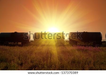 fuel tanks in sun rays - stock photo