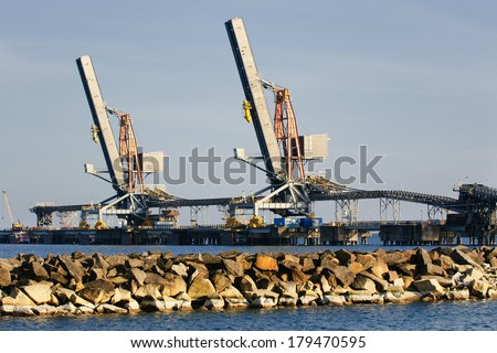 Fuel terminal industrial buildings in cargo port  - stock photo
