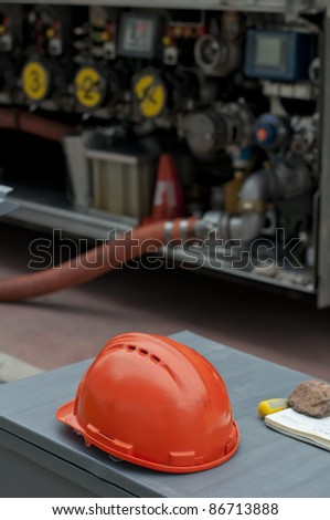 Fuel truck and red helmet close up - stock photo