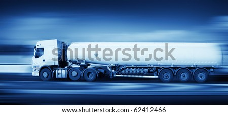 fuel truck in motion on highway and blurred background, monochromatic - stock photo