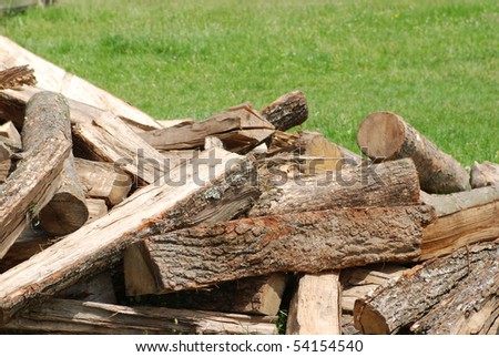 Fuel wood in stack prepared for the winter - stock photo