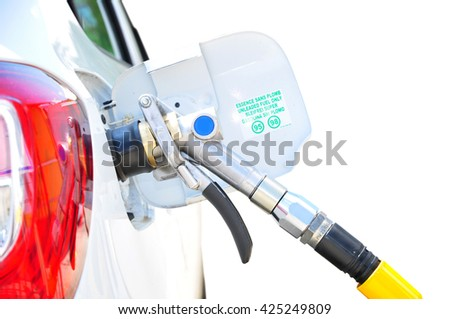 Fueling car by lpg gas nozzle - stock photo
