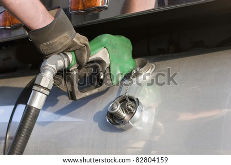 Fueling Up a Freight Transport Truck - stock photo