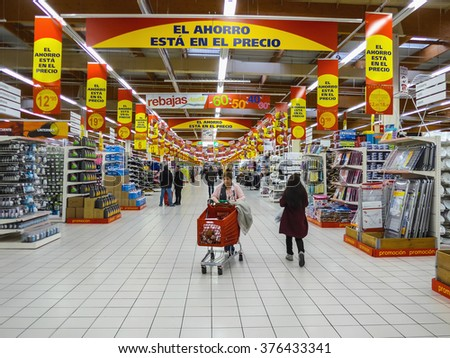 FUENLABRADA, MADRID, SPAIN - FEBRUARY 13, 2016: People Shopping for diverse products in Alcampo supermarket. Alcampo is a subsidiary of the Auchan hypermarkets group in Spain  - stock photo