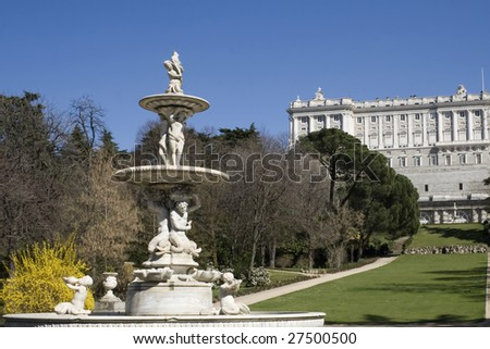 Fuente de las Conchas Madrid. Fountain of park of Campo del Moro. In background the Kings Palace of Madrid - Spain