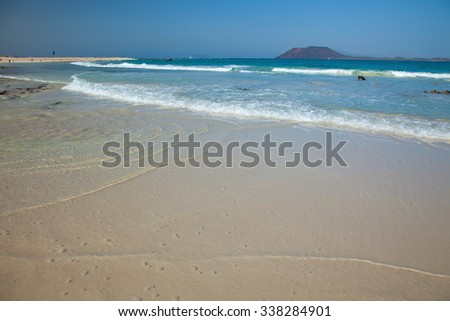 Fuerteventura, Canary Islands, Corralejo Flag Beach, tin layer of water over smooth white sand - stock photo