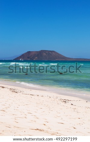 Fuerteventura: Grande Playas beach with view on Lobos Island on August 31, 2016. Grande Playas is a famous beach for kitesurfing and windsurfing. Lobos is a small island 2 km north of Fuerteventura