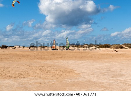 FUERTEVENTURA, SPAIN - SEPTEMBER 15, 2015:  People driving sand yachting on the beach. They are learning and having fun.Corralejo, Fuerteventura