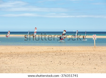 FUERTEVENTURA, SPAIN - SEPTEMBER 14, 2015: Windsurfing on the beach of Costa Calma .Fuerteventura, Canary Island . Spain
