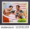 FUJAIRAH - CIRCA 1971: postage stamp printed in Fujairah of Union Arab Emirates showing an image of the fight between Muhammad Ali vs Joe Frazier in 1971 for the Heavyweight Championship, circa 1971. - stock photo