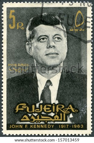 FUJEIRA - CIRCA 1965: A stamp printed in Fujeira shows Portrait of John F. Kennedy (1917-1963), circa 1965 - stock photo
