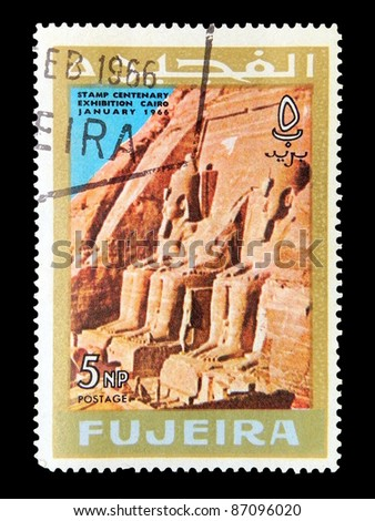 "FUJEIRA - CIRCA 1966: A stamp printed in Fujeira (UAE) shows Colossi at Abu Simbel with inscription and name of the series ""Stamp Centenary Exhibition, Cairo, January 1966"", circa 1966"