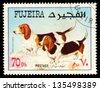 FUJEIRA - CIRCA 1980: Postage stamp printed in Fujeira showing dog dachshunds, circa 1980 - stock photo