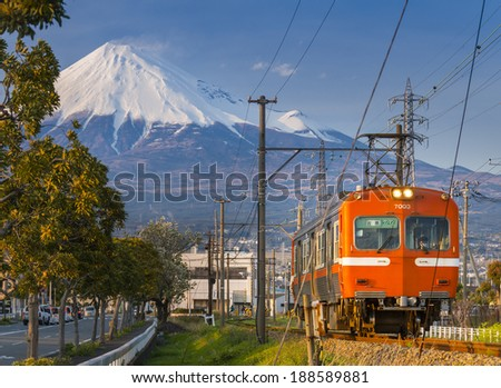 FUJI CITY, JAPAN-APRIL 6: Japan Rail train pulling into Fuji Station, April 6, 2014 in Fuji City. Train system is the most effective transportation in Japan with over 10 millions people using everyday - stock photo