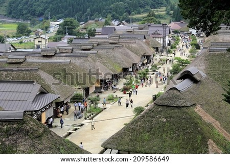 FUKUSHIMA,JAPAN - SEPTEMBER 7, 2013: Ouchijuku is a former post town along the Aizu-Nishi Kaido trade route, which connected Aizu with Nikko during the Edo Period. - stock photo