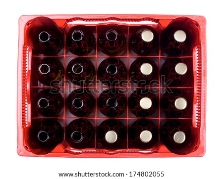 full and empty brown glass bottles of beer in red crate on white background