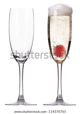 full and empty glass of champagne with strawberry isolated on a white background - stock photo