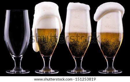 full and empty glass of light beer  isolated on a black background - stock photo