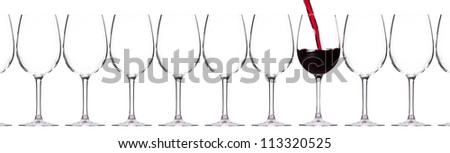 full and empty glass of red wine  isolated on a white background - stock photo