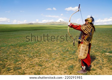 Full armored archer aiming to shoot. - stock photo