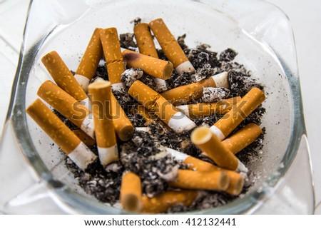 stock-photo-full-ashtray-with-smoked-cig