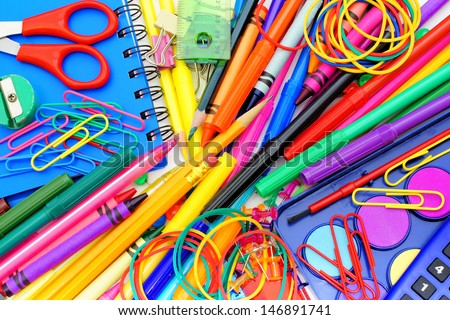 Full background of a colorful assortment of school supplies - stock photo