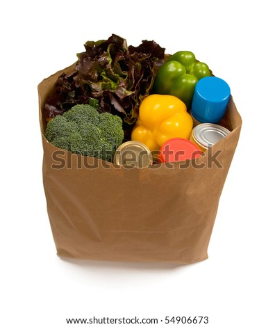 Full bag of groceries isolated on white. - stock photo