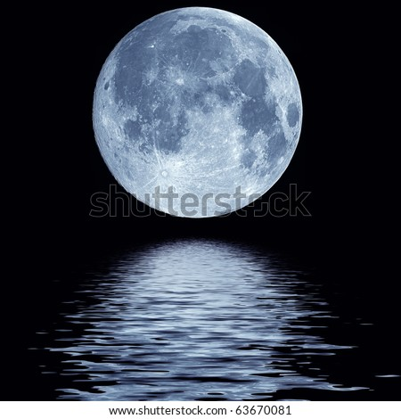 Full blue moon over cold night water - stock photo