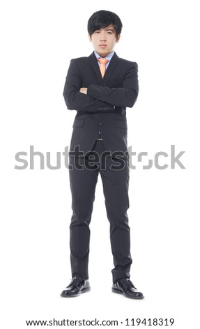 Full body Asian business man standing with crossed arms over white background - stock photo