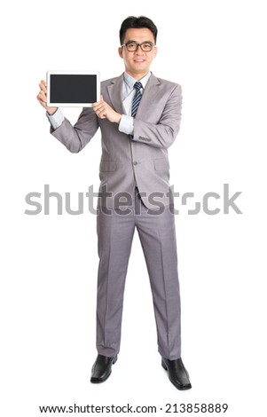 Full body Asian businessman hand holding digital computer tablet, standing isolated on white background. - stock photo