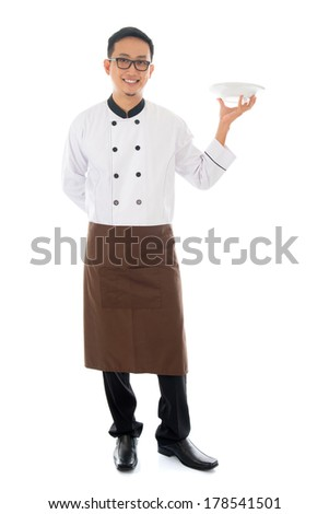 Full body Asian chef holding an empty plate ready for food, standing isolated on white background. - stock photo