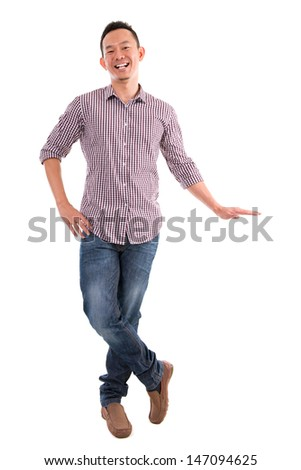 Full body Asian man putting hand on invisible banner over white background - stock photo